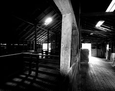 Inside the woolshed in black and white