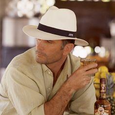 https://www.google.com/search?q=man on beach wearing panama hat