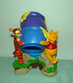 Dixie Cup holder with Winnie the Pooh, and Tigger. $8.00