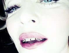 PHOTOS Madonna's grillz create buzz at Rome fitness club opening Grillz, Miley Cyrus, Gold Tooth Cap, Girls With Grills, Rihanna, Dental Jewelry, Jump The Shark, Worst Celebrities, Diamond Teeth