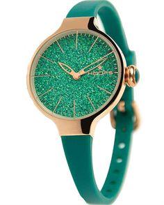 Από την εταιρεία της HOOPS και τη σειρά Cherie Glitter Gold ένα ρολόι με επιχρυσωμένη ροζ μεταλλική κάσα και πράσινο καουτσούκ με πράσινο καντράν με κρύσταλλα