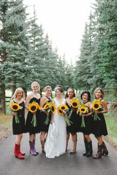 The ladies, their boots and the Sunflower bouquets by Boulder Blooms.