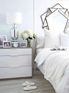Luxe modern bedroom. Love the geometric mirror above the bed.