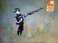 A 2011 Banksy mural in Los Angeles depicting a child with a machine gun shooting crayons instead of bullets. #remadeintheusa