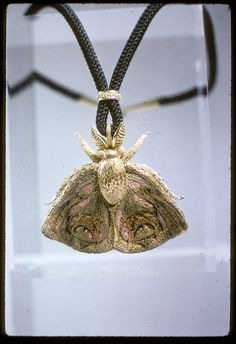 """Paul Miller Jewelry   Moth by John Paul Miller; pendant-brooch, gold, enamel; 1 3/4"""" x 2 1/8 ..."""