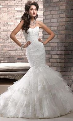 Maggie Sottero Adalee: buy this dress for a fraction of the salon price on PreOwnedWeddingDresses.com