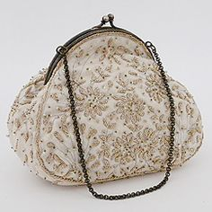 View our collection of Moyna beaded bridal purses & wedding handbags.  Exquisite purses, clutches,l handbags designed by Moyna.  Find your style at Perfect Details.