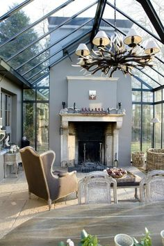 Winter garden in steel 6 with fireplace - realizations - Waver-Construct bvba - Winter garden in steel 6 with fireplace – realizations – Waver-Construct bvba -