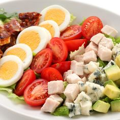 This lighter cobb salad is jam packed with fresh veggies in different shapes and textures creating an amazing meal topped with a zesty dijon dressing!