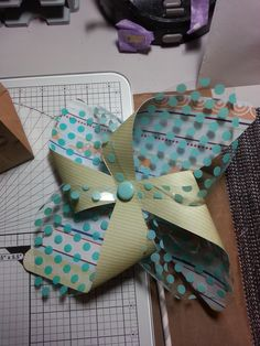 Made by Teresa Penfold - This Pinwheel has been made using the Pinwheel Board and papers, acetate and accessories from We R Memory Keepers.