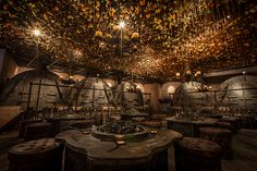 vials of 'fairy dust' and metal-making tools decorate the interior of the iron fairies bar that appears to have come straight from a fairytale book.