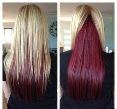 Choppy blonde hair with burgundy underneath the bangs.