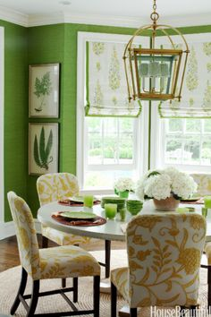Green dining room with yellow floral chairs   #greenery #pantonecoloroftheyear2017