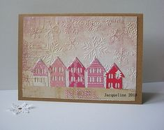 A little whimsical Christmas card using scraps of paper to diecut the houses