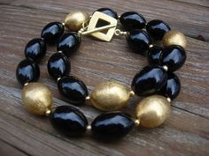 Custom Made Black Onyx with gold beads necklace and earrings by Silver Frog Jewelry Studio