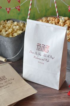Use tin tie favor bags personalized with a design and up to 4 lines of custom print at your wedding popcorn bar for guests to fill with their favorite flavored popcorn to enjoy during and after your reception. Tin tie bags feature a thin, flexible metal tie at the top of each bag, that folds over to keep contents fresh and secure. Tin tie popcorn favor bags can be ordered at http://myweddingreceptionideas.com/personalized_large_tin_tie_goodie_bags.asp