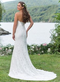 Sheer illusion panels in the neckline and back embellish this straight allover lace gown with a strapless neckline. The jersey lining will have you feeling comfortable all day. https://www.sweetheartgowns.com/sweetheart/6159