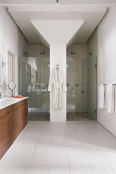 This is great planning.  They took an existing element, a structural column and organized a shower symmetrically around it.  Cool.