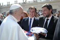 Pope Francis And Sports San Lorenzo de Almagro soccer team President Matias Lammens, right, hands Pope Francis a team jersey at the end of the pope's weekly general audience, in St. Peter's Square at the Vatican, Wednesday, April 10, 2013. (AP Photo/L'Osservatore Romano, ho)