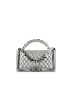 Boy CHANEL flap bag with handle, metallic calfskin & ruthenium metal-silver…
