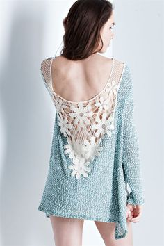 A two toned cut&sew sweater top featuring deep scoop back with see-through crochet lace. Slit side with high-low back. Knit.
