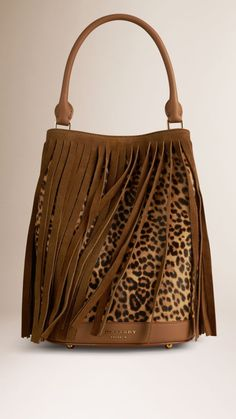 Honey/dark sand The Bucket Bag in Animal Print Shearling And Fringing - Image 1 Leather Purses, Leather Handbags, Leather Bag, Handbag Accessories, Fashion Accessories, Animal Print Fashion, Animal Prints, Boho Bags, Patchwork Designs