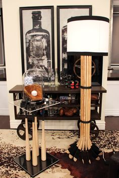 Baseball-bat table and hockey stick lamp. Would be great DIY furniture for a sports theme rec room.