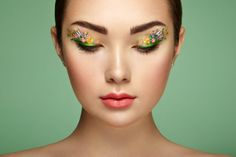 Young beautiful woman with flower makeup eyes / 500px
