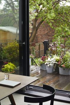 like the flowers in metal? planters clustered on deck. Cost-Conscious and Inventive: A Flood-Proofed Brooklyn Townhouse Rebuild by Takatina Brownstone Interiors, Townhouse, Rooftop Terrace, Terrace Garden, Balcony Gardening, Metal Stairs, Open Space Living, Metal Planters, Nordic Home