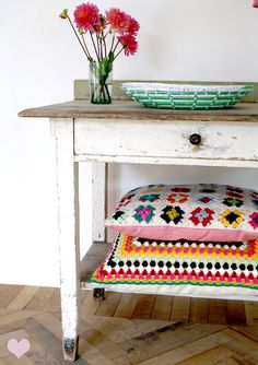 Great idea to place under the table throw pillows in the colors and/or patterns that  compliment the room. 20 Ways to Decorate With Flowers For Spring | StyleCaster