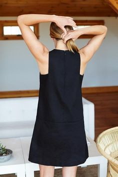 Cut Out Mod Dress - Black A soft, structured, 100% cotton twill A-line style dress  Features front welt pockets  8 inch neckline opening w/ hook + eye closures