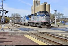 A rare visitor as AMTK P32-8BWH #503 and AMTK P42DC #93 provide power to Amtrak Empire Builder Train #8 as it pulls in for it's station stop at Red Wing, MN. Photo taken 4/18/15 near MP 370.69 on the CP River Sub