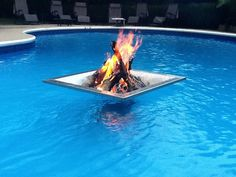 Floating Fire Pit...awsome idea....till you melt the fuck out of the liner and your pool drains. BRILLIANT!