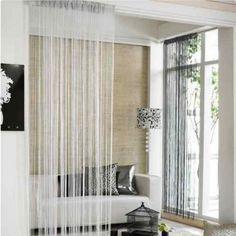 Separación de ambientes interiores con cortinas