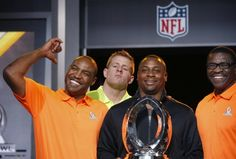 As Troy Vincent, second from right, NFL Executive Vice President of Football Operations, holds the Pro Bowl Trophy, and Michael Irvin, right, NFL Hall of Fame player and Pro Bowl Alumni team captain, the group poses for photographers, Darren Woodson, left, NFL Hall of Fame player and Pro Bowl Alumni co-captain, smiles as he points to Houston Texans Pro Bowl Player J.J. Watt, second from left, who jokingly jumps into the group picture during the Pro Bowl Kickoff news conference Tuesday, Jan…