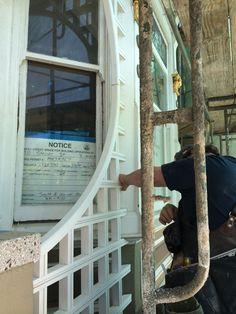 Restoring the half moon lattice on the facade of 710 Steiner, (the James Frank Moroney house), 2014,