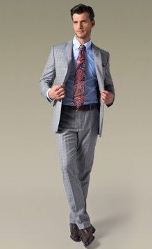 Grey checked suit, light blue shirt.