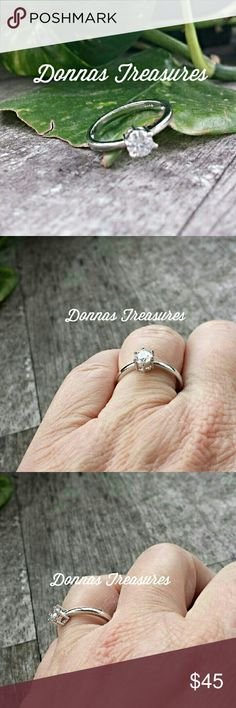Sterling Silver Engagement /Promise Ring This simple ring features a 0.5 round white Crystal in a Stering Silver Claw Setting. You'll love how it looks on your finger!  #0829-1 Jewelry Rings