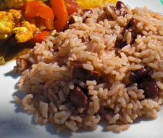 Jamaican Rice and Peas Recipe - Frugal Mom Eh!<br> Traditional Jamaican Rice & Peas recipe - Great accompaniment to most Jamaican entrees! Jamaican Cuisine, Jamaican Dishes, Jamaican Recipes, Rice And Peas Jamaican, Jamaican Oxtail, Guyanese Recipes, Pea Recipes, Indian Food Recipes, Vegetarian Recipes