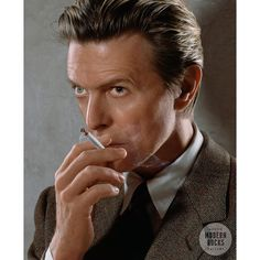 "Museum quality fine art print of David Bowie by photographer Markus Klinko, from his celebrated collection ""Bowie Unseen""., released for the first time in 2016.  This shot of David Bowie smoking is from a shoot for British GQ Magazine in 2002"