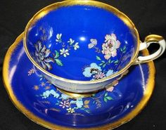 Paragon Royal Blue Butterfly Gold Wide Tea Cup and Saucer