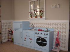 Lots of different ideas on how to build your own play kitchen with dimensions and tutorial