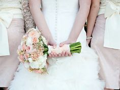 The flowers designed in this bride's bouquet are Juliet english garden roses, stock, Ilse spray roses, ranunculus, lisianthus, and blush caspia!