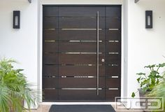 Dynamic Garage Door - Santa Ana, CA, United States. Orange County, CA Modern Entry Doors in Solid Mahogany Wood. Custom contemporary front door design with Stainless Steel Tubular Handle.