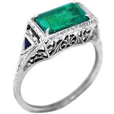 1.5c. Emerald ring. unusual cut and sapphires on the edges?! *swoon*