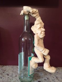 """Wood carving bottle stopper """"hang on"""" by Dwayne Gosnell"""