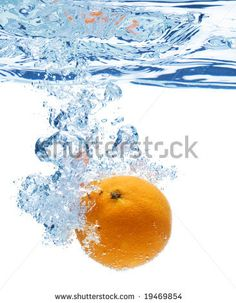 stock photo : A background of bubbles forming in blue water after orange is dropped into it.