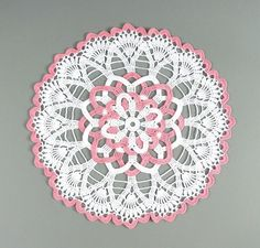 Pretty Crocheted White & Rose Pink Rosette Doily.My mom crocheted beautiful doilies like these in the late 1940's y