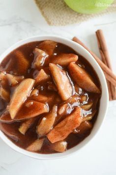 Crock Pot Cinnamon Apples - easy and delicious spiced apples! Perfect served with ice cream, on pancakes, or eaten with a spoon! ~ https://www.julieseatsandtreats.com