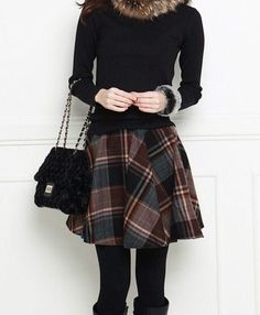 plaid circle skirt, black top, tights and boots